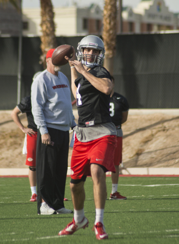 UNLV quarterback Kurt Palandech (14) throws the ball during the first day of spring practice at the Rebel Park practice fields on the UNLV campus in Las Vegas on Monday, March 7, 2016. Daniel Clar ...