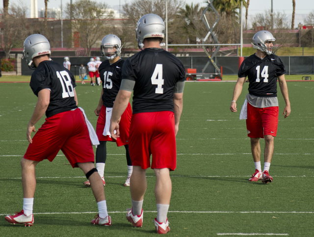 UNLV quarterback Kurt Palandech (14) walks toward the other contenders for the starting quarterback position during the first day of spring practice at the Rebel Park practice fields on the UNLV c ...