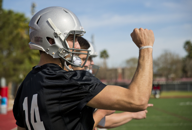 UNLV quarterback Kurt Palandech (14) signals to players on the field during the first day of spring practice at the Rebel Park practice fields on the UNLV campus in Las Vegas on Monday, March 7, 2 ...