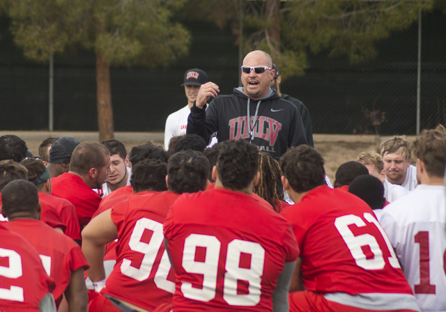 UNLV football head coach Tony Sanchez speaks with his team at the end of the first day of spring practice at the Rebel Park practice fields on the UNLV campus in Las Vegas on Monday, March 7, 2016 ...