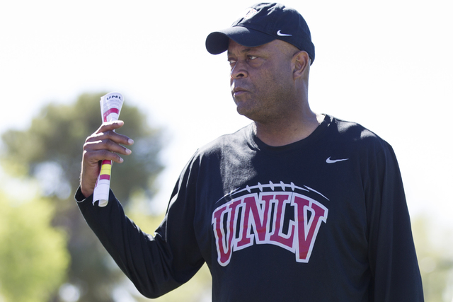 UNLV 's defensive line coach Tony Samuel gives directions to his players during a football team practice at Rebel Park on Wednesday, March 9, 2016, in Las Vegas. Erik Verduzco/Las Vegas Review-Jou ...