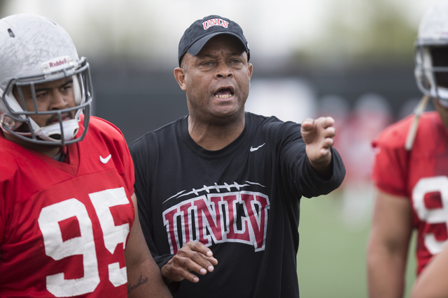 UNLV 's defensive line coach Tony Samuel gives directions to his players during a football team practice at Rebel Park on Friday, March 11, 2016, in Las Vegas. Erik Verduzco/Las Vegas Review-Journ ...