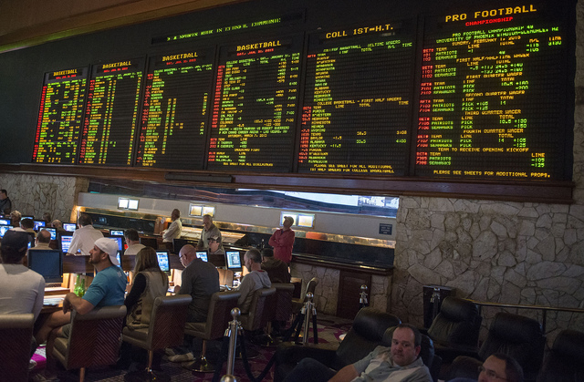 The odds board at the Mirage in Las Vegas on Saturday, Jan. 31, 2015. Gamblers wagered over $100 million on the Super Bowl in 2014. (Jacob Kepler/Las Vegas Review-Journal)