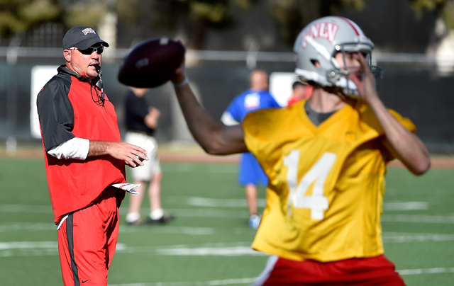 DAVID BECKER/LAS VEGAS REVIEW-JOURNAL UNLV football coach Tony Sanchez watches his team run drills, including quarterback Kurt Palandech, during the first day of spring practice at Rebel Park on M ...