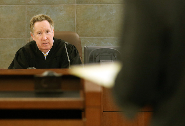 Judge Ronald Israel listens to testimony during a court hearing involving Clark County School District teachers at the Regional Justice Center Thursday, March 10, 2016, in Las Vegas. The hearing a ...