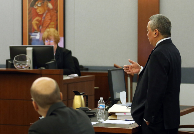 Jon Okazaki, right, counsel for Clark County School District, appears before Judge Ronald Israel during a court hearing at the Regional Justice Center Thursday, March 10, 2016, in Las Vegas. The h ...