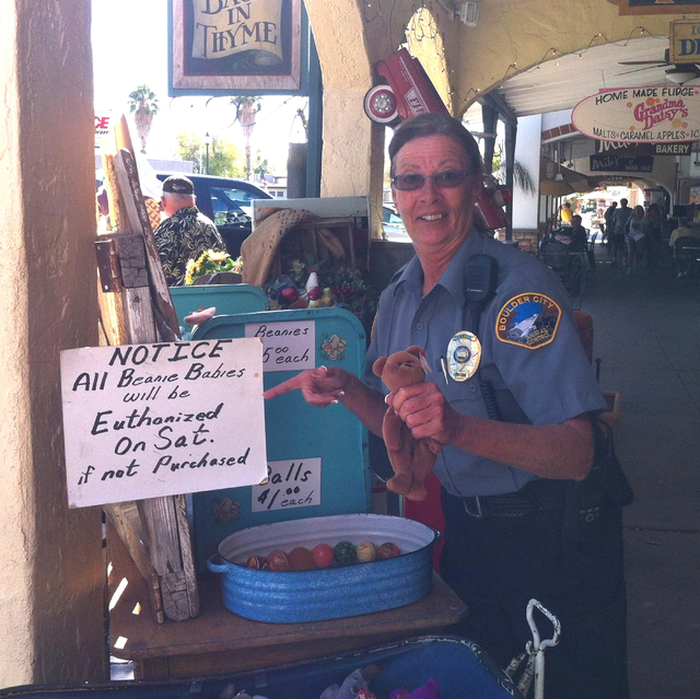 Former Boulder City Animal Control Supervisor Mary Jo Frazier poses after asking to have her photo taken with a store display outside a Boulder City business. Courtesy photo
