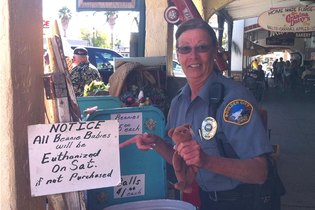 Former Boulder City Animal Control Supervisor Mary Jo Frazier poses after asking to have her photo taken with a store display outside a Boulder City business. (Courtesy)