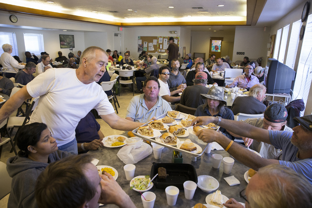 """Peter Montgomery, a volunteer at Friends in the Desert for the past seven years, serves apple pie for dessert at St. Timothy's Episcopal Church March 22. """"I'm only working part time now,"""" Montgo ..."""
