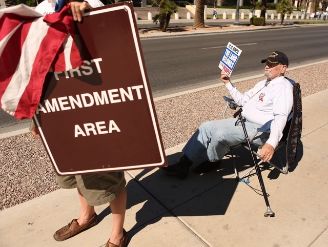Mesquite resident Robert Deihl demonstrates in his chair outside the Lloyd George Federal Building on Thursday, March 10, 2016, in Las Vegas. (Jeff Scheid/Las Vegas Review-Journal)