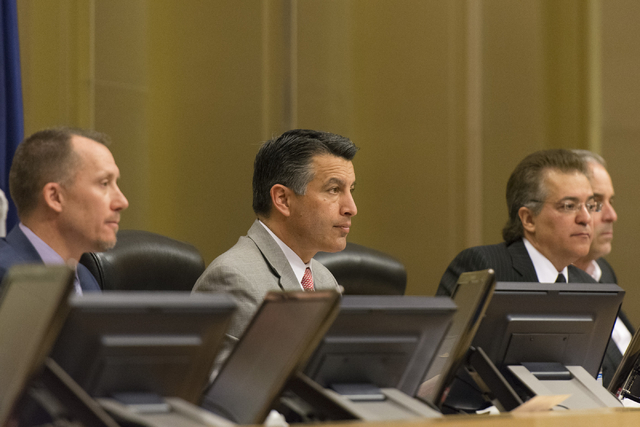 From left, A.G. Burnett, chairman of the Nevada Gaming Control Board, Nevada Governor Brian Sandoval, Tony Alamo, chairman of the Nevada Gaming Control Board and Blake Sartini, President and CEO o ...