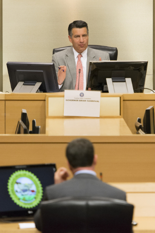 Nevada Governor Brian Sandoval, top, speaks to Geoff Freeman, CEO of the American Gaming Association, during the Nevada Gaming Policy Committee meeting at Las Vegas City Hall Council Chambers Mond ...