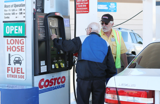 Costco employe, David Jackson, right, assists a customer at a Costco gas station on 6555 N. Decatur Blvd., Wednesday, March 9, 2016, in Las Vegas. Bizuayehu Tesfaye/Las Vegas Review-Journal Follow ...