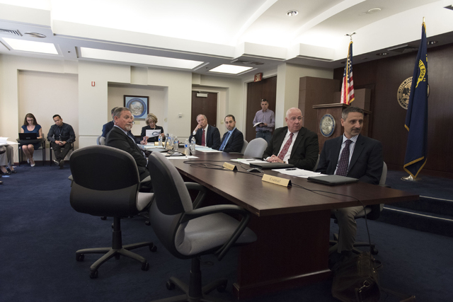 Brian Gaumer, director of test and development engineering with Hyperloop Technologies, right, speaks with Gov. Brian Sandoval in Carson City via teleconference during a board meeting at the Gover ...
