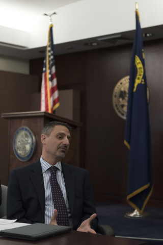 Brian Gaumer, director of test and development engineering with Hyperloop Technologies, speaks with Gov. Brian Sandoval in Carson City via teleconference during a board meeting at the Governor's O ...