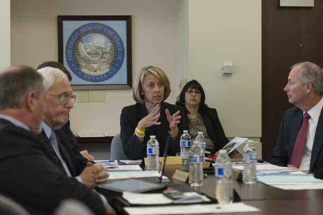 Nevada Secretary of State Barbara Cegavske, center, speaks with Gov. Brian Sandoval in Carson City via teleconference during a board meeting at the Governor's Office of Economic Development to dis ...
