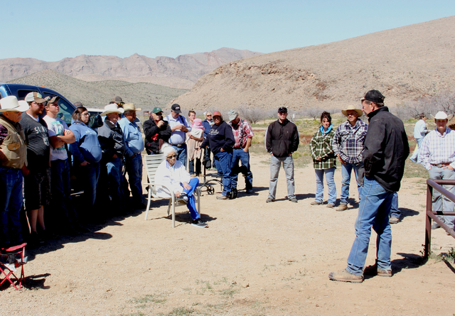Residents from across northeastern Clark County gather Saturday, March 26, 2016, near the restored grave of Arthur Coleman at the Gold Butte ghost town site 100 miles northeast of Las Vegas. Colem ...