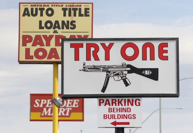 A sign is advertised for The Gun Store Monday, March 21, 2016, in Las Vegas. Nevada was ranked number one for the most gun-related hashtags on Instagram. Ronda Churchill/Las Vegas Review-Journal