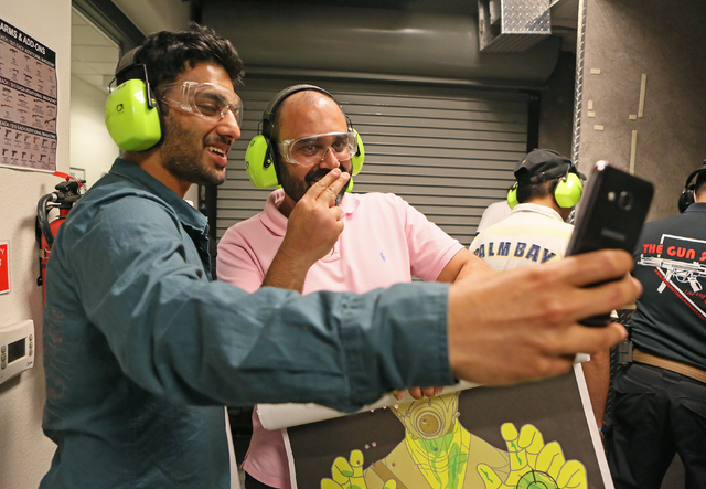 Mak Singh, left, and Kam Bharj pose for a selfie at The Gun Storeճ indoor range Monday, March 21, 2016, in Las Vegas. The men were with a group from England for a bachelor party. Nevada was  ...