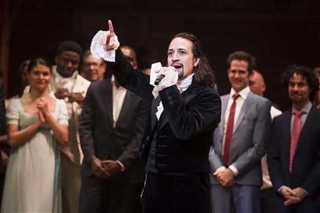 """Lin-Manuel Miranda appears at the curtain call following the opening night performance of """"Hamilton"""" in New York, Aug. 6, 2015. The cast of the hit Broadway show will make an appearance at the Whi ..."""