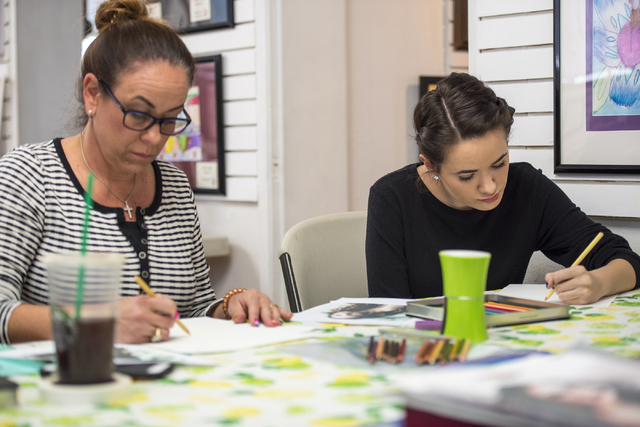 Shawn Orluske, left, and Kaitlin Orluske draw during an art class at City Lights Art Gallery March 12. Joshua Dahl/View