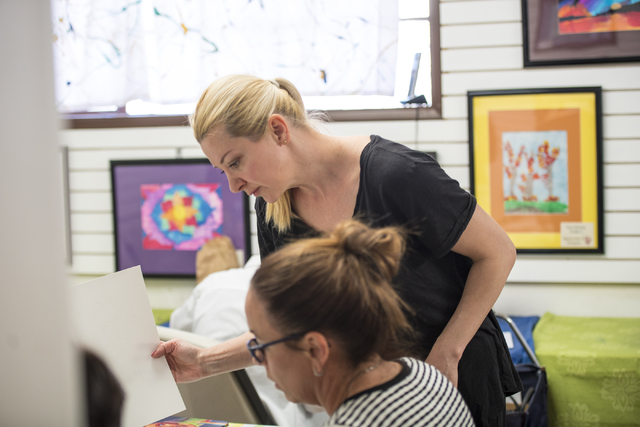 Instructor Anna Hammer helps Shawn Orluske during an art class at City Lights Art Gallery in Henderson March 12. Joshua Dahl/View