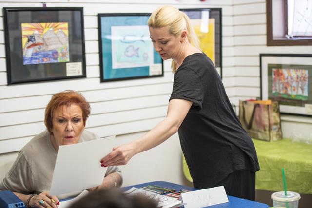 Instructor Anna Hammer helps Anne Sheridan during an art class at City Lights Art Gallery March 12. Joshua Dahl/View