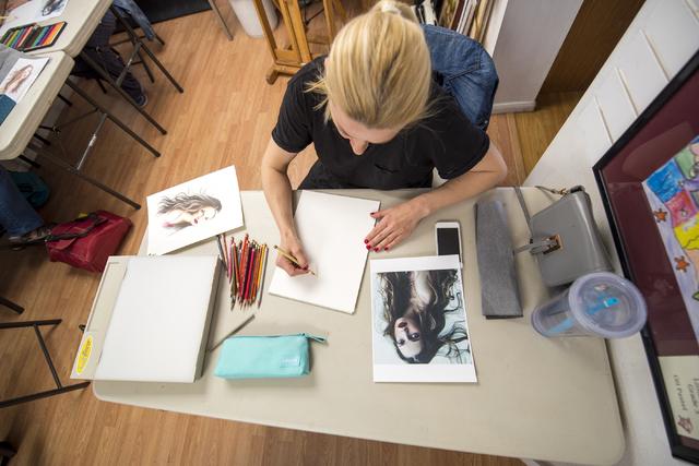 Instructor Anna Hammer draws during an art class at City Lights Art Gallery March 12. Joshua Dahl/View