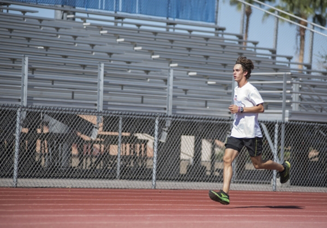 Green Valley High School senior Austin Rogers, 16, jogs during cross country practice at the Green Valley High School track, 460 N. Arroyo Grande Blvd., Aug. 24, 2015. The school is set to be the  ...