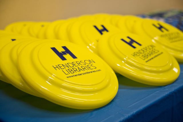 Frisbees branded with the new Henderson Libraries logo sit on a table at the Green Valley Library March 1. Daniel Clark/View