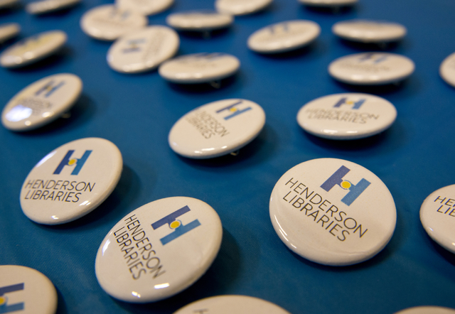 Pins branded with the new Henderson Libraries logo sit on a table at the Green Valley Library March 1. Daniel Clark/View