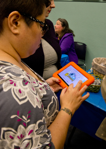 Kristine Segura interacts with a new Playaway Launchpad at the Green Valley Library March 1. Daniel Clark/View