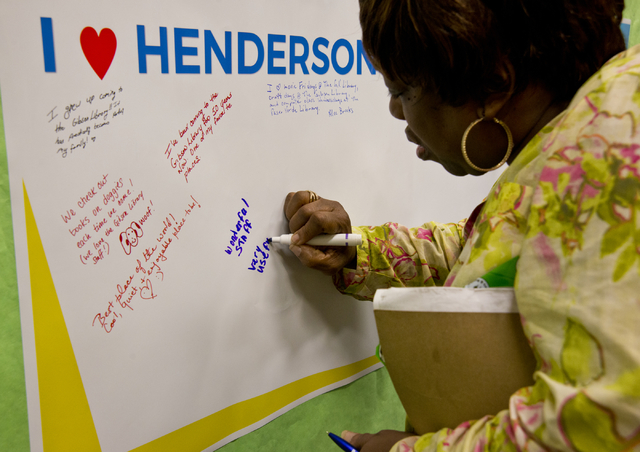 Joanne Washington leaves a message on a poster at the Green Valley Library in Henderson March 1 during event introducing the library system's new logo and website. Daniel Clark/View