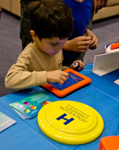 Jacoby King interacts with a new Playaway Launchpad at the Green Valley Library March 1. Daniel Clark/View