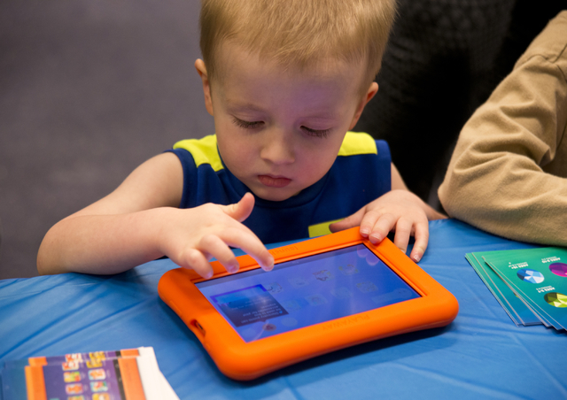 Oliver Williams interacts with a new Playaway Launchpad at the Green Valley Library March 1. Daniel Clark/View