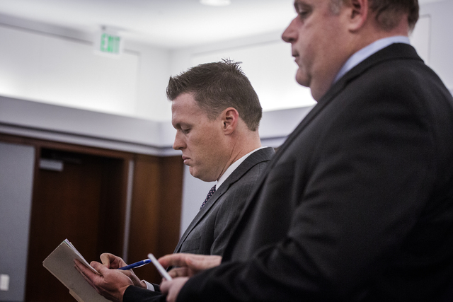 Attorneys Bennair Bateman, representing Philip Frank Panzica III, and Chris Rasmussen, representing Chloe Scordianos, appear for their clients at Regional Justice Center on Wednesday,  March 9, 20 ...