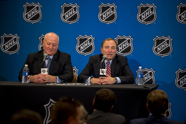 NHL Commissioner, Gary Bettman, addresses media, along side Bill Daly, NHL Deputy Commissioner, during a news conference at the MGM Grand Garden Arena in Las Vegas on Wednesday, June 24, 2015. (Jo ...