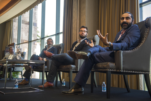 Senior Vice President of Sales for Cvent Bharet Malhotra, right, speaks during an educational panel event discussing technology trends in hospitality from the MGM Grand conference center in Las Ve ...