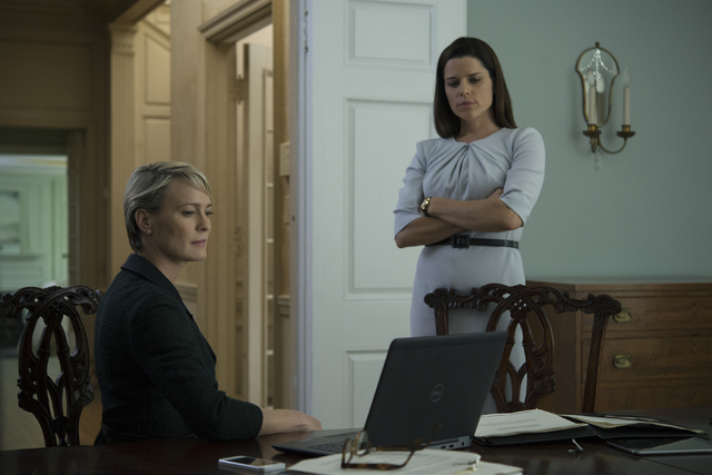 "Robin Wright, left, and Neve Campbell appear in a scene from ""House of Cards."" (David Giesbrecht/Netflix)"
