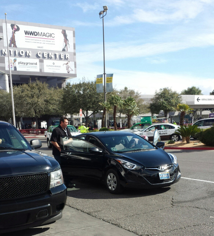 In this photo provided by private investigator David DuCharme of The DuCharme Agency, an Uber driver talks to a potential client at Las Vegas Convention Center north portico Feb. 18, 2016. Private ...