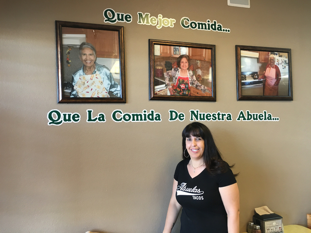Leslie Valdes poses for a photo next to her grandmother, center, who inspired her to open Abuela's Tacos, 4225 E. Sahara Ave., in the midst of the recession. Sandy Lopez/View