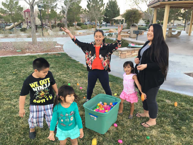 Poliahu Davis, center, and her family and friends play with Easter eggs at Prescott Park, 4433 Haven Point Ave., in North Las Vegas, March 1. Sandy Lopez/View
