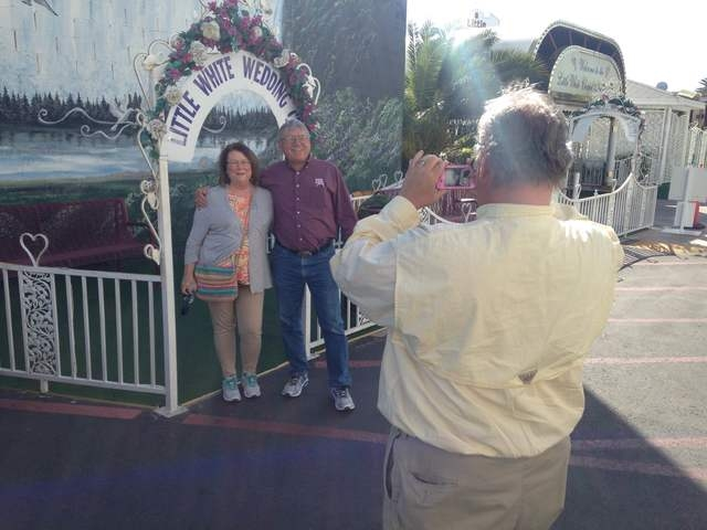 Pink Jeep tour guide Richard Evans photographs Gary Hafernick and Peggy Hafernick in front of the Little White Chapel on Tuesday, March 8, 2016. Kimberly De La Cruz/Las Vegas Review-Journal