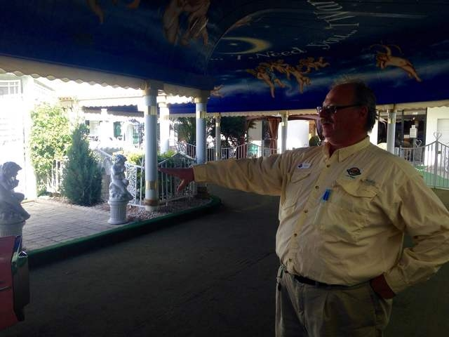 """Pink Jeep tour guide Richard Evans points to the pink Cadillac in the """"Tunnel of Love"""" at the Little White Chapel during a tour of the Strip on Wednesday, March 8, 2016. Kimberly De La Cruz/Las Ve ..."""