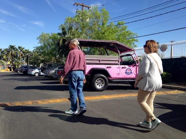 Gary and Peggy Hafernick walk back to their Pink Jeep tour after seeing the Little White Wedding Chapel on Wednesday, March 8, 2016. Kimberly De La Cruz/Las Vegas Review-Journal