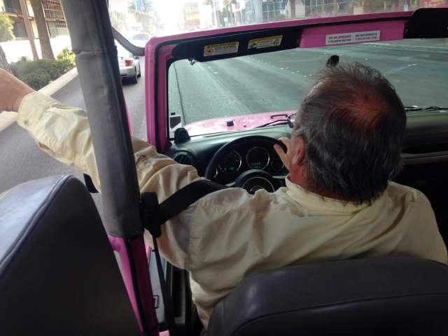 Pink Jeep tour guide Richard Evans points out landmarks during a tour of the Strip on Wednesday, March 8, 2016. Kimberly De La Cruz/Las Vegas Review-Journal