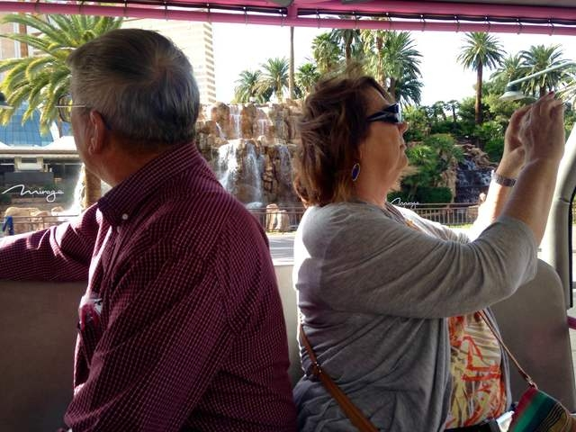 Gary and Peggy Hafernick stop to photograph sites on the Strip during a Pink Jeep tour on Wednesday, March 8, 2016.