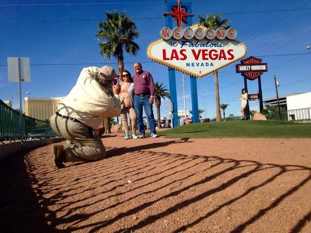 "Pink Jeep tour guide Richard Evans photographs Gary and Peggy Hafernick in front of the ""Welcome to Fabulous Las Vegas"" during a tour of the Strip on Wednesday, March 8, 2016. Kimberly De La Cruz/ ..."