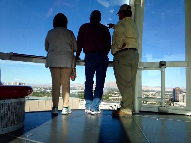 Pink Jeep tour guide Richard Evans points out landmarks from the High Roller to Gary and Peggy Hafernick during a tour of the Strip on Wednesday, March 8, 2016. Kimberly De La Cruz/Las Vegas Revie ...