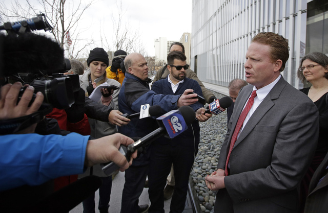 Utah businessman Jeremy Johnson speaks with reporters outside the Federal Courthouse Friday, March 25, 2016, in Salt Lake City. (AP Photo/Rick Bowmer)